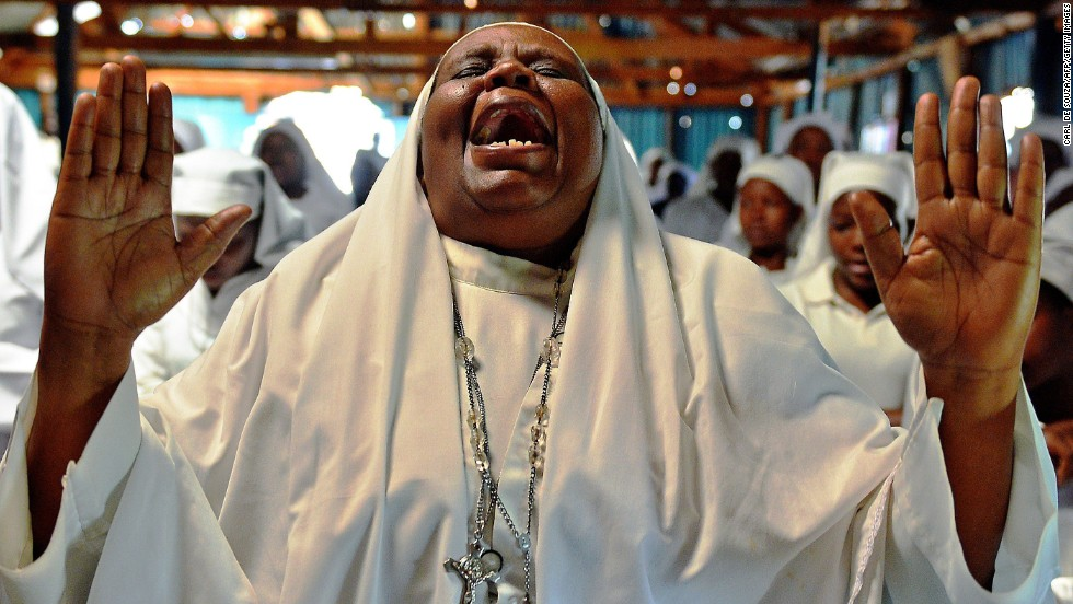 A woman shouts during a special prayer at the Legio Maria African Mission church in Nairobi, Kenya, on Sunday, September 29, for the victims of the Westgate Shopping Mall shooting.