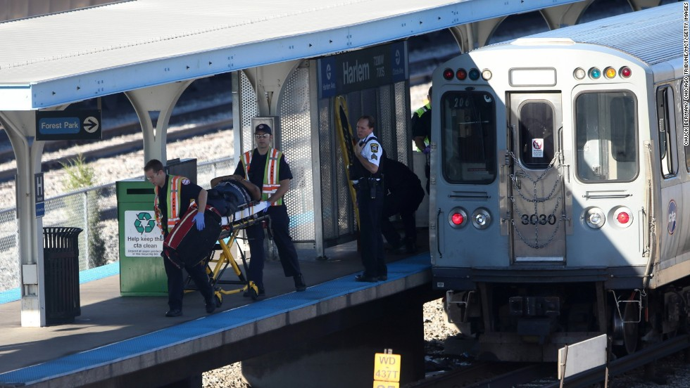 An injured rider is transported after the crash. Authorities are looking at video feeds from the platforms and from some rail cars.