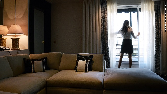 """Domesticated but exotic, banal but never boring. Hotels are more """"homely"""" than home, says the author."""