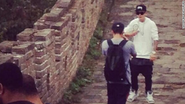 Justin Bieber, safe and secure on top of the Great Wall of China. A snap of the superstar letting his bodyguards carry him up the stairs has earned him a fair bit of mockery at home and abroad.