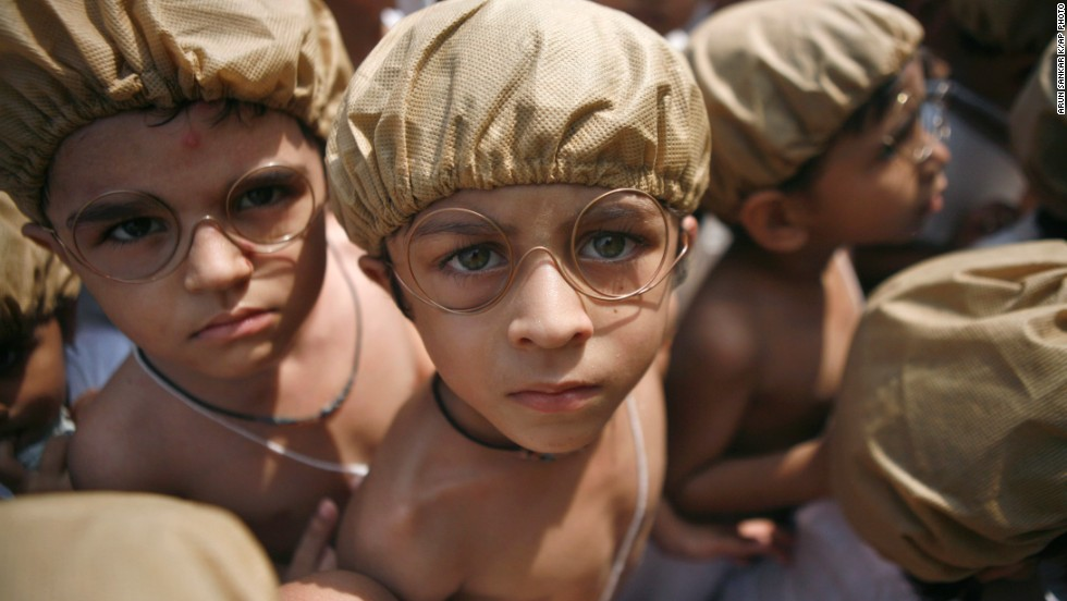 "OCTOBER 2 - CHENNAI, INDIA Children dressed as Mahatma Gandhi perform at an event to mark the anniversary of his birth. The late leader of India's independence movement remains the <a href=""http://www.cnn.com/2010/WORLD/asiapcf/11/08/india.obama.trip/index.html?iref=allsearch"">nation's greatest hero</a>. Gandhi's doctrine of non-violent protest <a href=""http://www.cnn.com/2011/09/28/opinion/kohn-tradition-of-protests/index.html?iref=allsearch"">inspired movements for civil rights and freedom</a> across the world."