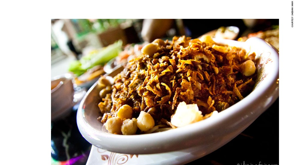 On the North African tour menu is koshari, the quintessential Egyptian comfort food -- a carb-heavy bowl of rice, pasta and macaroni, tossed with lentils, chickpeas, fried onions and a rich tomato sauce.
