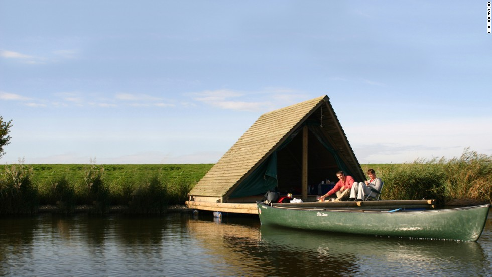 """These 129-square-foot """"raft tents"""" are comfortable but basic -- campers bring their own sleeping equipment but garbage bins, gas lights, camp stoves and camp chairs are provided. Each raft comes with its own canoe so guests can check out the river setting."""