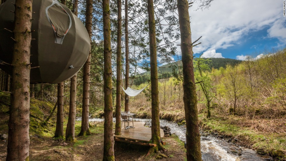The Red Kite Tree Tents are canvas domes suspended from trees. They're large enough to accommodate two adults and there's even a wood-burning stove. The tents have electric lighting and are insulated for year-round use.