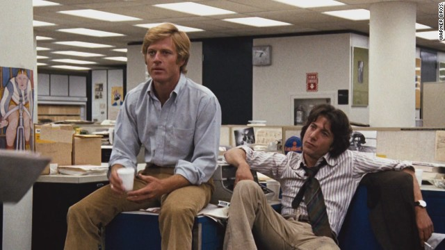 "Robert Redford portrays Bob Woodward and Dustin Hoffman Carl Bernstein in the 1976 film ""All the President's Men."""