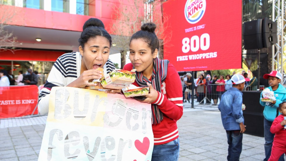 Girls tuck in to their lunches outside the Burger King in Cape Town.