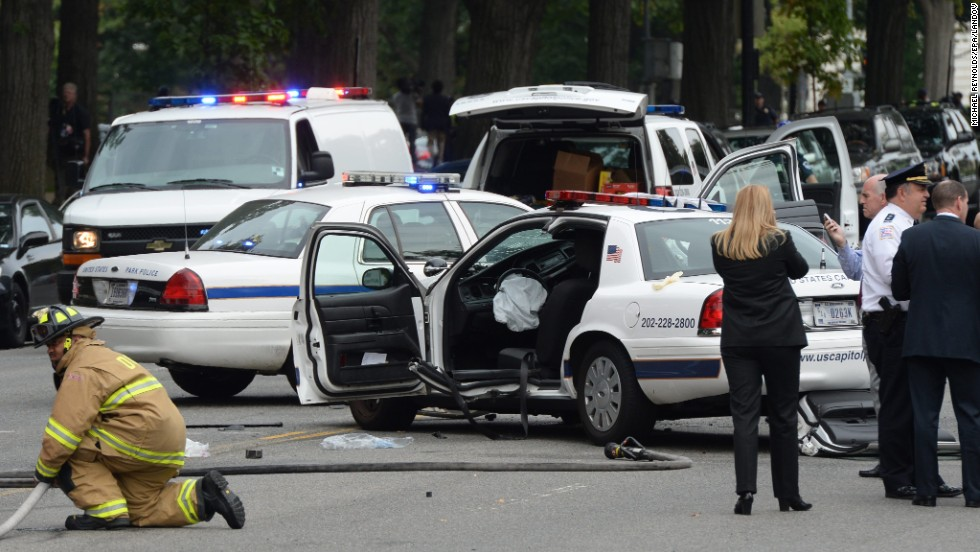A damaged U.S. Capitol Police car is seen after the car chase and reported shooting incident.