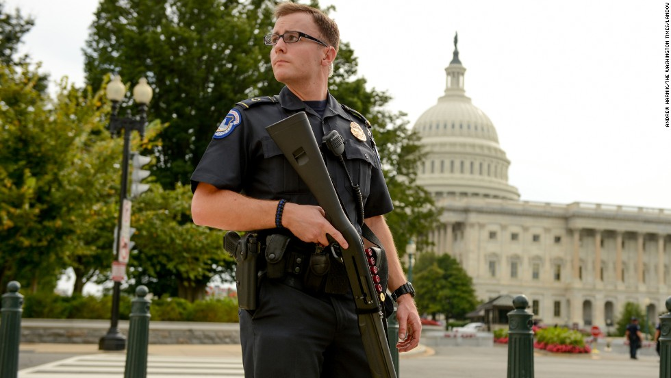 A U.S. Capitol Police Officer stands guard in front of the Capitol.