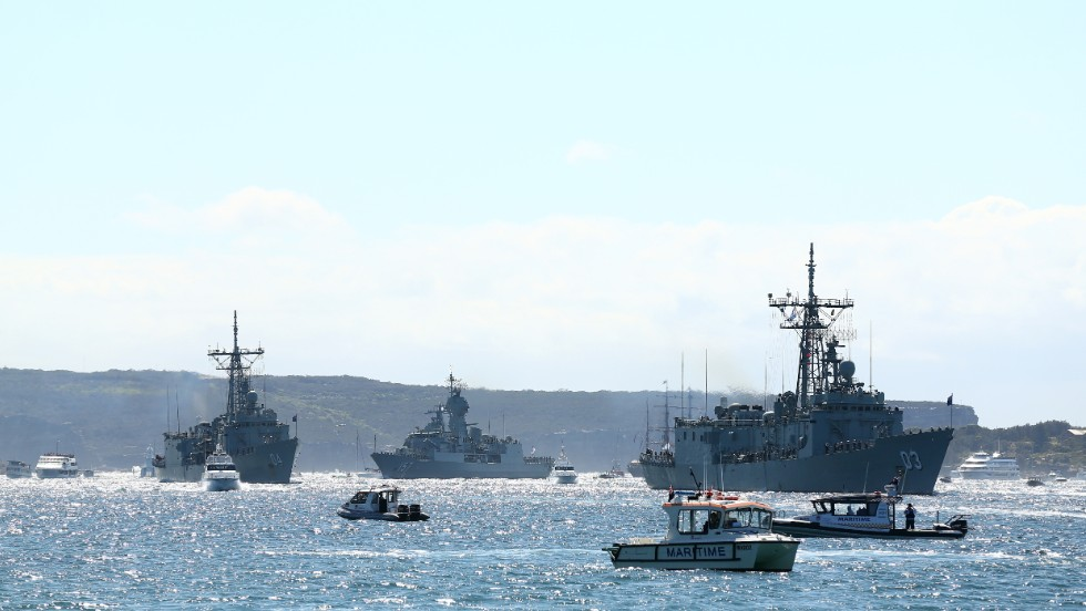 The HMAS Sydney, HMAS Darwin and HMAS Perth enter the harbor on October 4.