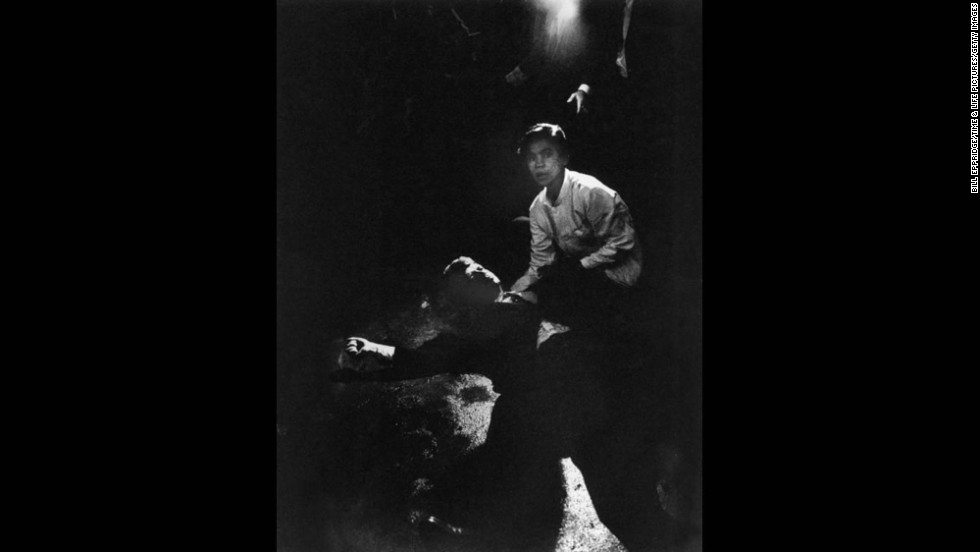 "Photojournalist Bill Eppridge, who photographed Sen. Robert F. Kennedy moments after he was fatally shot in Los Angeles in 1968, died October 3. ""Rigid, semiconscious, his face an ashen mask, Senator Kennedy lies in a pool of his own blood on the concrete floor, a bullet deep in his brain and another in his neck. Juan Romero, a busboy whose hand Kennedy had shaken before the shots, tried to comfort him."" <a href=""http://life.time.com/bill-eppridge/"" target=""_blank"">See more of Eppridge's work at Life.</a>"