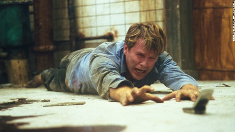 "For almost the entire running time of ""Saw"" (2004), a corpse lies in a pool of blood on the floor of well-hidden washroom. Meanwhile, two chained figures, played by Cary Elwes and Leigh Whannell, realize they're part of a brutal serial killer's game. After much gore and misdirection, the serial killer is revealed to be the corpse -- who's not so dead after all."