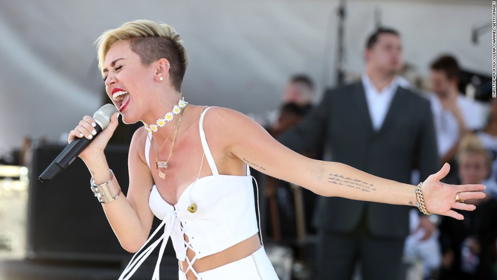 Several of Cyrus' tattoos are exposed at the iHeart Radio Music Festival Village in Las Vegas on September 21.