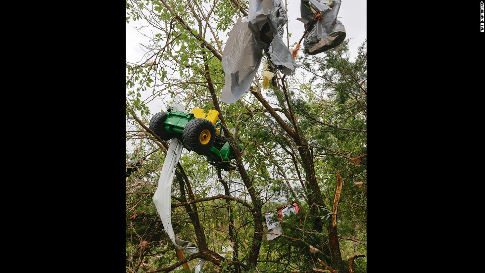 Debris, including a toy tractor, hang in a tree following a tornado in Hickman, Nebraska, on October 4.