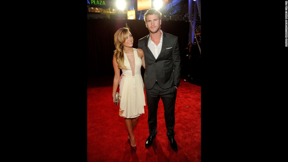 Cyrus and Liam Hemsworth arrive at the 2012 People's Choice Awards at the Nokia Theatre L.A. Live in January 2012 in Los Angeles.