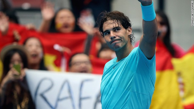 Rafael Nadal acknowledges the crowd in Beijing after Tomas Berdych retires with an injury in their semifinal.