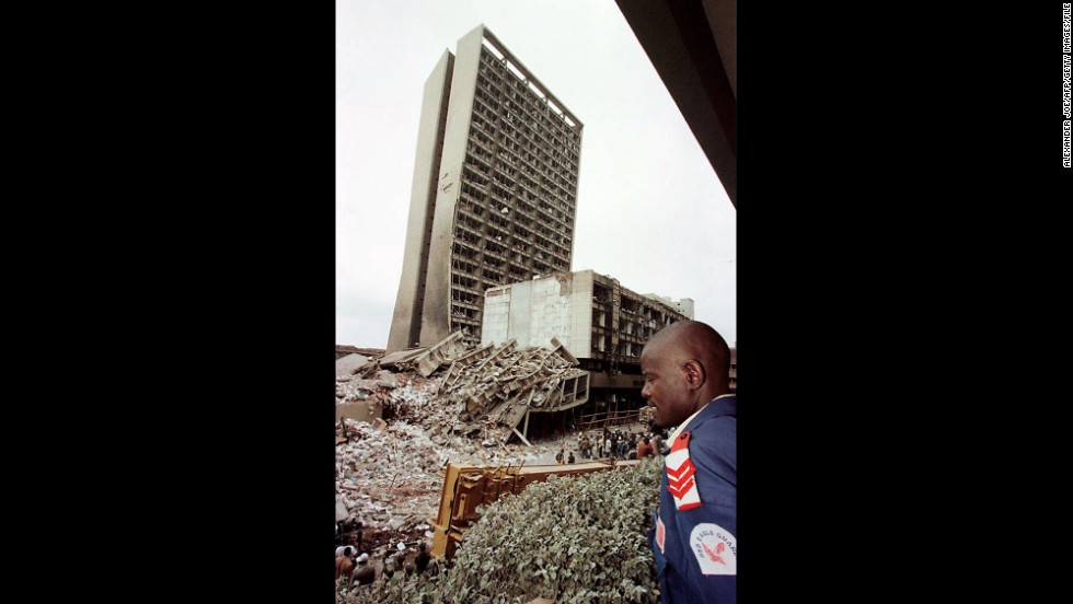 A guard looks over the site of the bomb blast on August 8, 1998, in Nairobi, Kenya.