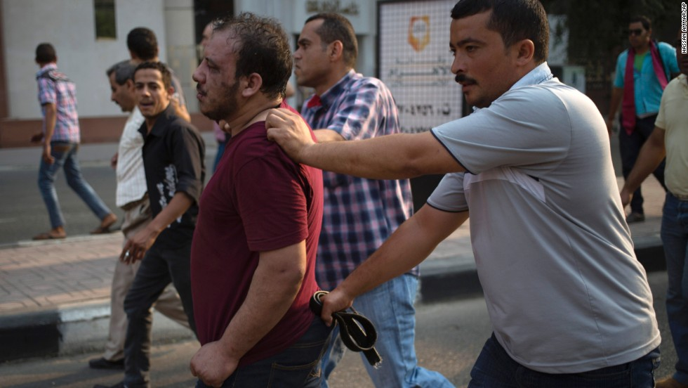 Egyptian security forces detain a suspected Morsy supporter in Cairo on October 6.