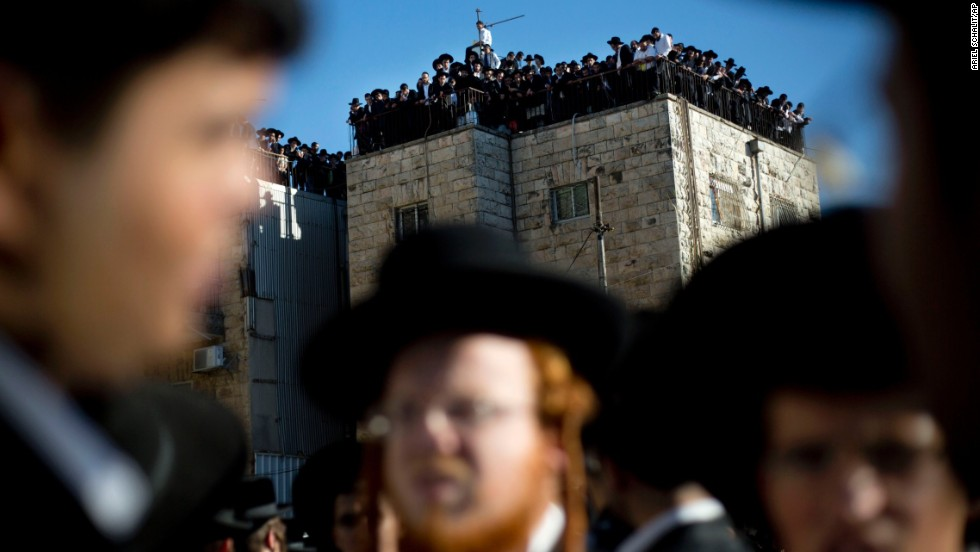 Orthodox Jews watch Yosef's funeral procession on October 7 in Jerusalem.