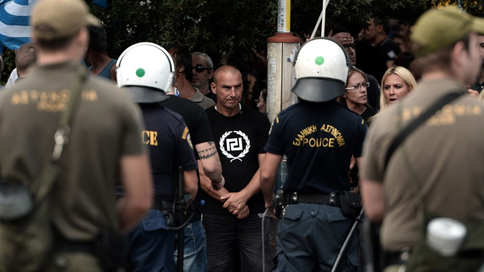 Greece's Golden Dawn supporters gather outside an Athens court on October 2, 2013 as four lawmakers from the neo-Nazi party were charged with belonging to a criminal organization.