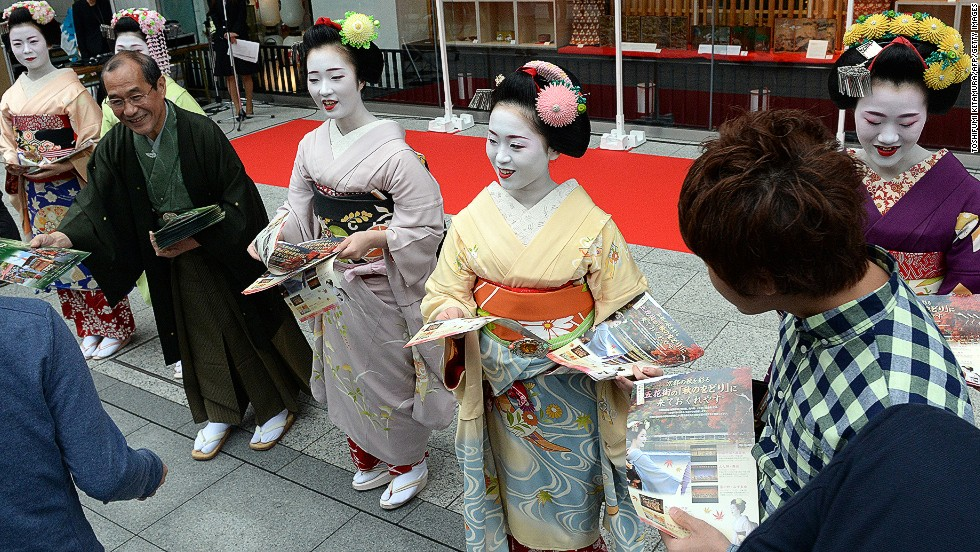 "A group of young apprentice geisha -- the oldest is 20 years old -- make a special appearance in Tokyo as part of a campaign called ""We are alive and well, Kyoto."" The promotion is part of efforts to lure tourists back to Kyoto following last month's floods, the result of Typhoon Man-yi. For centuries, one of Kyoto's biggest draws has been the sight of traditional geisha heading to their evening engagements."