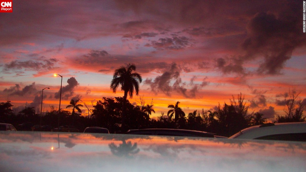 "Scott Stransky, a natural disaster surveyor, captured a glimpse of beauty while investigating the aftermath of Hurricane Irene in August 2011. ""This photo was taken in the parking lot at sunrise at Nassau International Airport in the Bahamas, with the scene reflecting slightly off the roof of my rental car."""