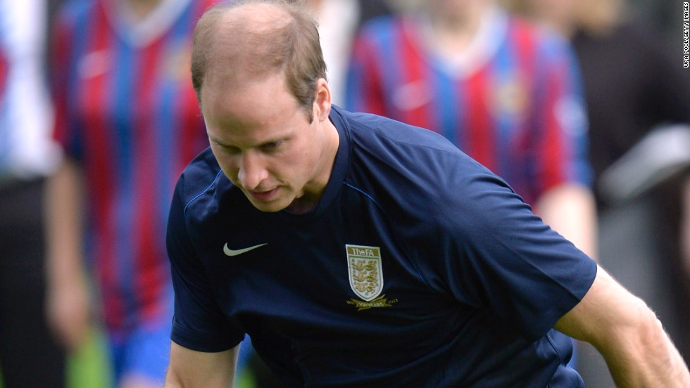 Prince William is a measure of concentration as he practices his skills in a training session with members of the Royal Household.