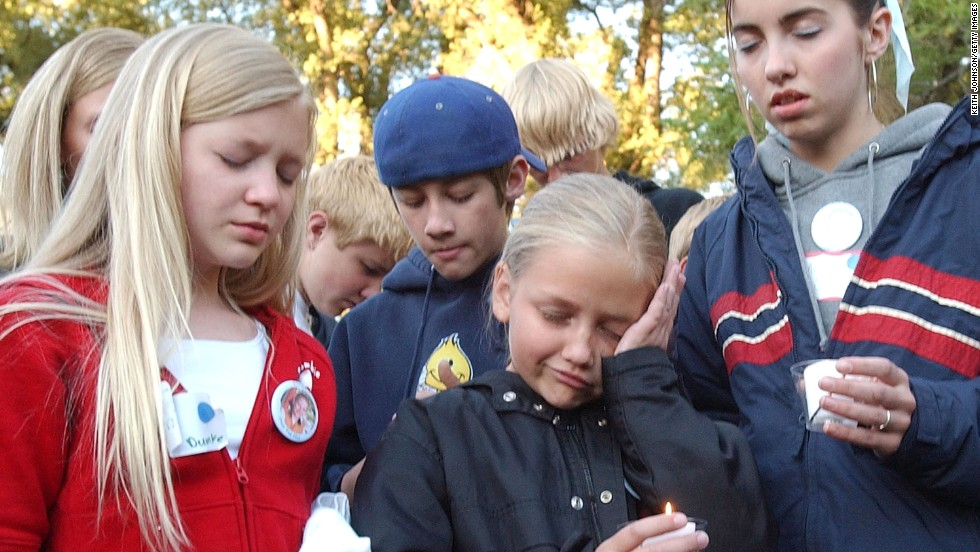 Smart's cousins Tori Dumke, from left, Cessilee Smart and Alicia Smart join supporters during a candlelight vigil in June 2002 in Salt Lake City.