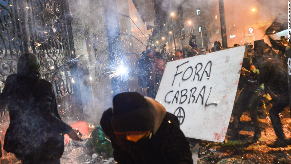 Masked demonstrators appear to attempt to break through a gate at Rio de Janeiro's City Hall on October 7.
