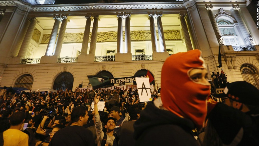 Demonstrators gather in front of a government building on October 7 during the protest.