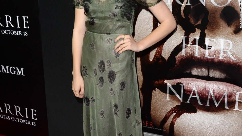 "Chloe Grace Moretz glows on the red carpet at the October 7 premiere of her new movie, ""Carrie."""