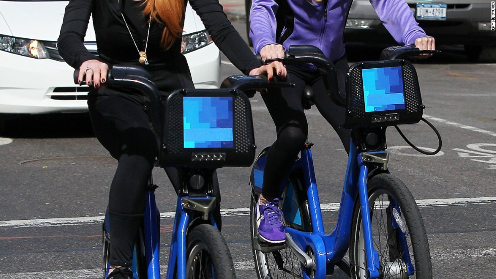 Lindsay Lohan and mom Dina cruise through New York City on bikes.