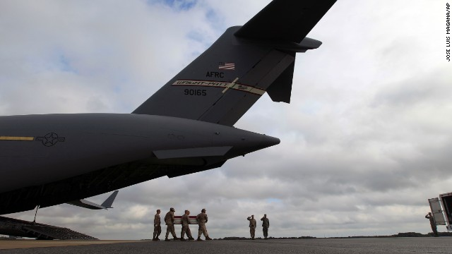 A Marine carry team carries the transfer case containing the remains of Marine Lance Cpl. Jeremiah M. Collins Jr. of Milwaukee, upon arrival at Dover Air Force Base, Del., on Monday, Oct. 7,  2013. The Department of Defense announced the death of Collins Jr., who was supporting Operation Enduring Freedom in Afghanistan. ( AP Photo/Jose Luis Magana)