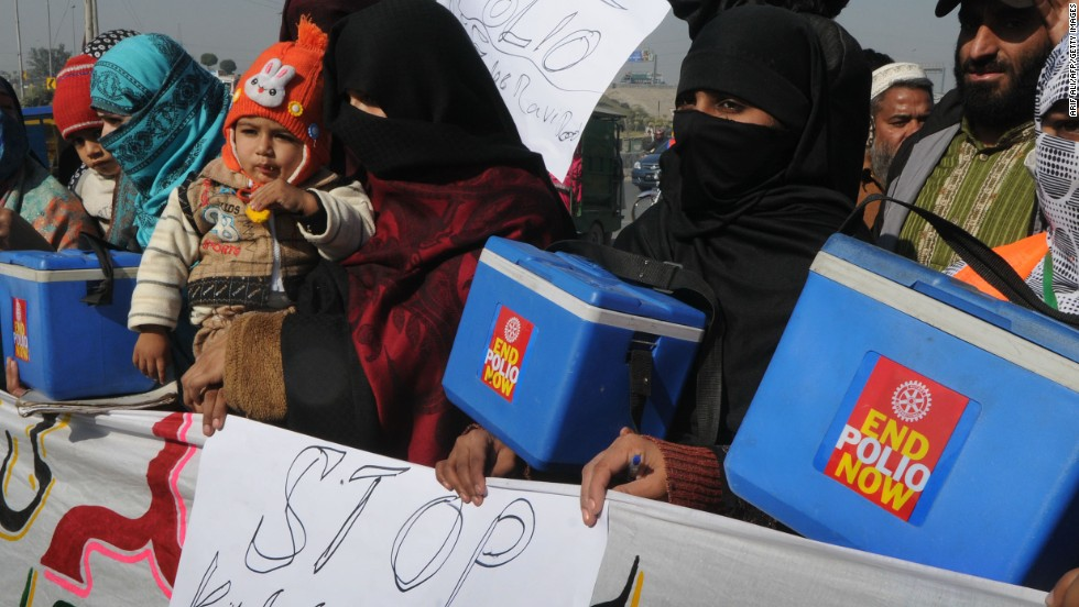 Pakistani polio vaccination workers carry placards during a protest against the killing of their colleagues in Lahore on December 21, 2012.