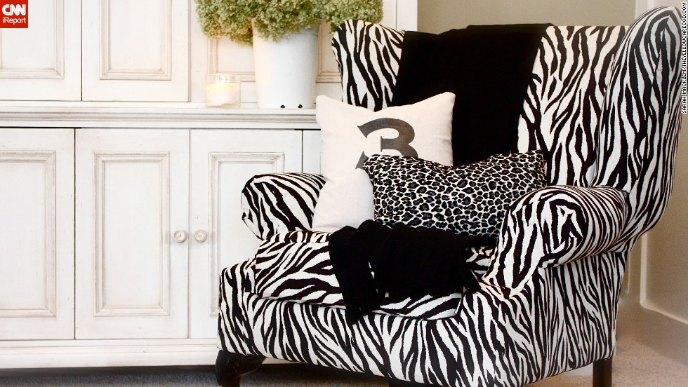 """<a href=""""http://ireport.cnn.com/docs/DOC-1041602"""">Sarah Macklem's</a> updated cottage style includes this <a href=""""http://www.theyellowcapecod.com/2010/02/dr-suess-chair-how-to.html"""" target=""""_blank"""">black-and-white tiger stripe upholstery</a> on a wingback chair with ball-and-claw feet."""
