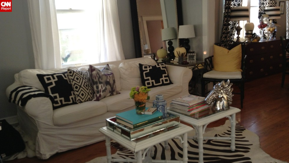 """<a href=""""http://ireport.cnn.com/docs/DOC-1042194"""">Krista Byers </a>says her living room is decorated almost exclusively with <a href=""""http://www.goodwillglam.com/"""" target=""""_blank"""">thrift store and Craigslist finds</a>, including the zebra-hide rug and silver horse figurine."""