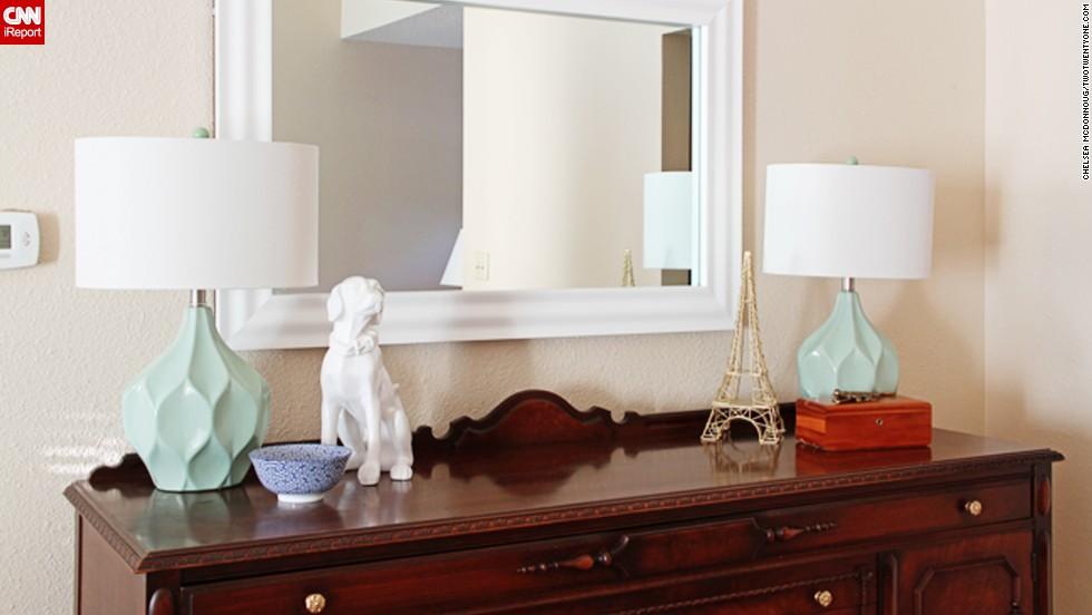 "<a href=""http://ireport.cnn.com/docs/DOC-1040611"">Chelsea McDonnough</a> adds <a href=""http://www.twotwentyone.net/"" target=""_blank"">sentimental decor</a> to an inherited buffet with this white ceramic dog figurine."