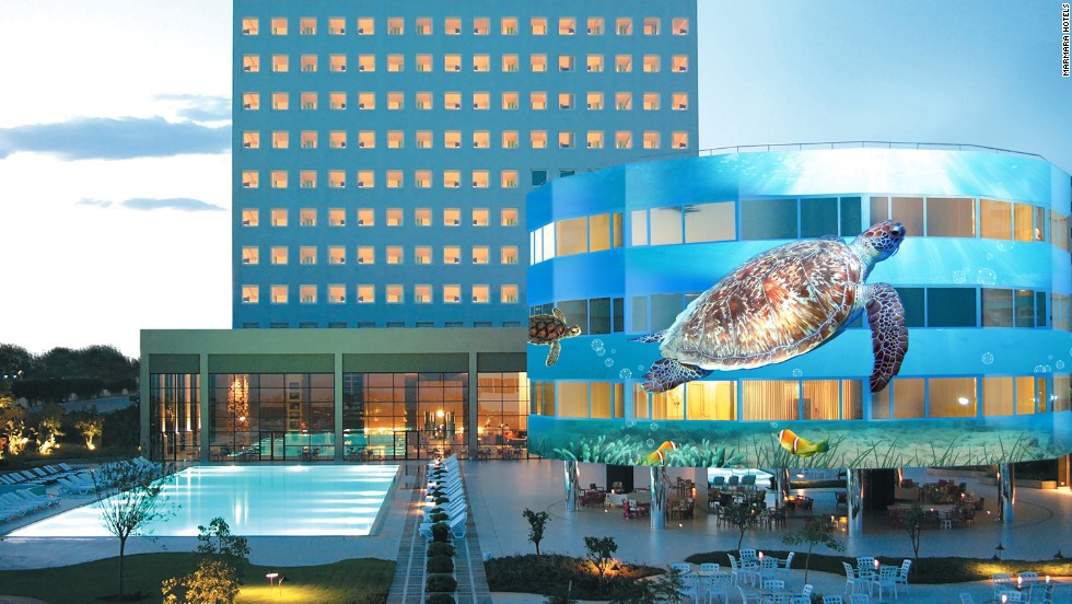 Marmara Antalya is the world's first revolving hotel. The 2,750-ton building floats in a tank holding 478 tons of water. The hotel's three lower floors are submerged, and it's the three floors above ground which rotate, with the help of six electric motors.