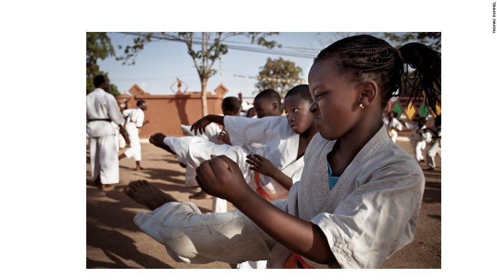 Jeannette Nikiéma, 13, practices karate at a martial arts school three times a week in Burkina Faso, West Africa. Karate, though not as popular as boxing, is well established in the country. Though usually nothing more than a spartan space with no real teacher, they attract young people eager to copy the moves they have seen on action films from Asia at their local video club.