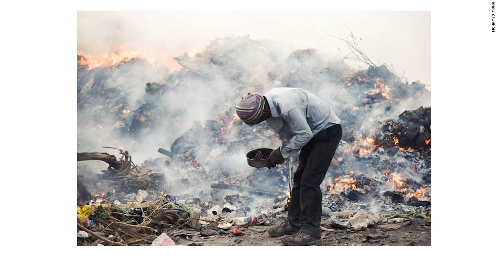 A migrant worker scavenges for materials in a landfill in the Maldives. Thilafushi is an artificial island created by filling one of the Maldives' shallow lagoons with garbage. More than 300 tons of rubbish are brought to Thilafushi each day. Workers earn US$300 a month by burning the rubbish and selling scavenged materials.