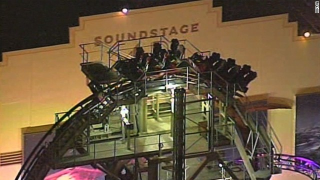 A roller coaster at Universal Orlando stalled because of a technical glitch about 140 feet above the ground.