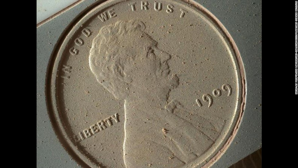 "Martian dust appears on the surface of a penny that was brought along with the Curiosity rover and photographed by the <a href=""http://mars.nasa.gov/msl/mission/instruments/cameras/mahli/"" target=""_blank"">Mars Hand Lens Imager</a> on October 2. The image of the 1909 coin is at the highest resolution possible for the high-powered camera: 14 micrometers per pixel (a micrometer is about .000039 inches)."