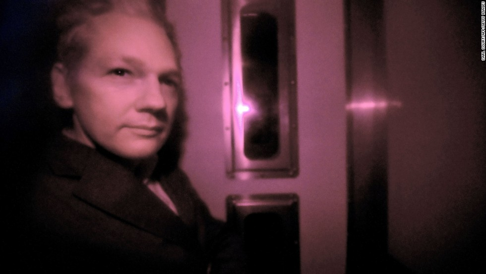 Assange sits behind the tinted window of a police vehicle at Westminster Magistrates court in London on December 14, 2010. Assange had turned himself in to London authorities on December 7 and was released on bail and put on house arrest on December 16.
