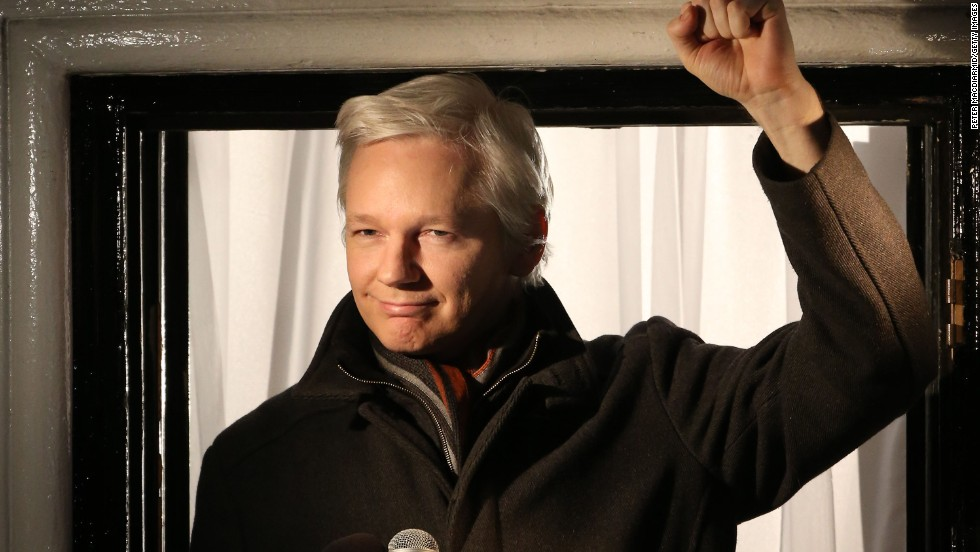 Assange speaks from a window of the Ecuadorian Embassy in London on December 20, 2012. Facing arrest by British officials, Assange has not set foot outside the embassy since June 2012.