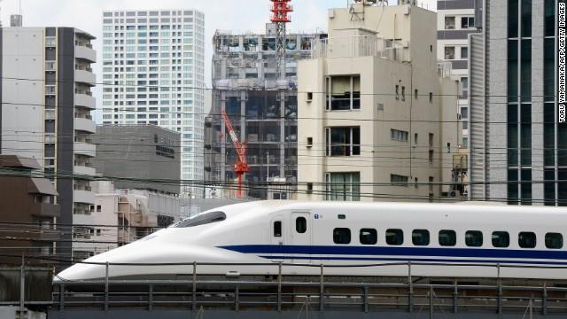 "The ""shinkansen,"" or bullet train, is still a thrill to see speeding through Tokyo."