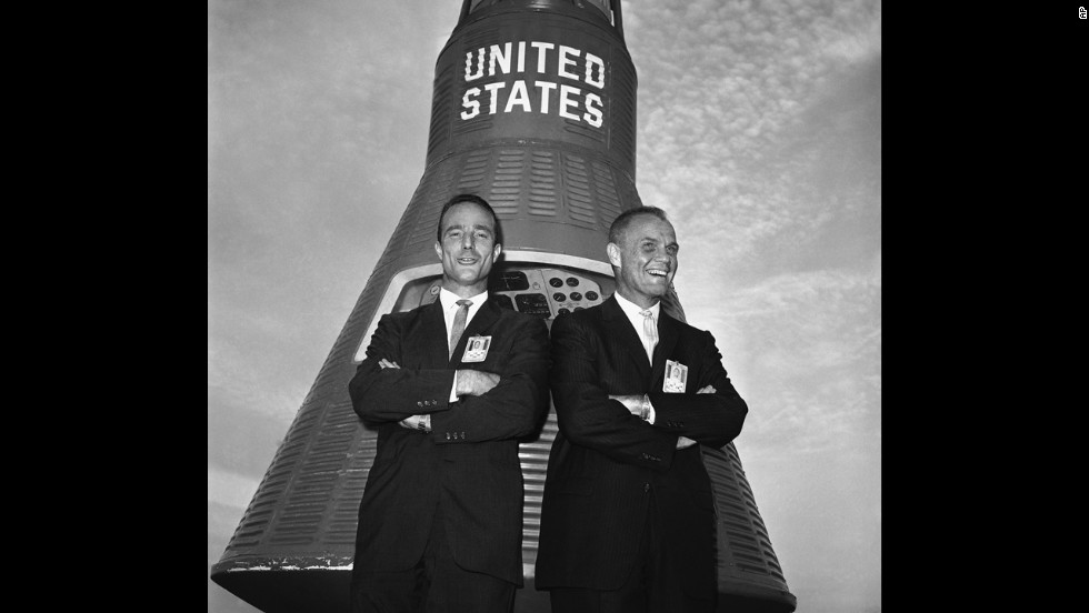Glenn, right, and Carpenter in front of a Mercury Capsule after Glenn was named to make the country's first manned orbital flight, on November 29, 1961, in Cape Canaveral, Florida. Carpenter was chosen as his backup pilot.