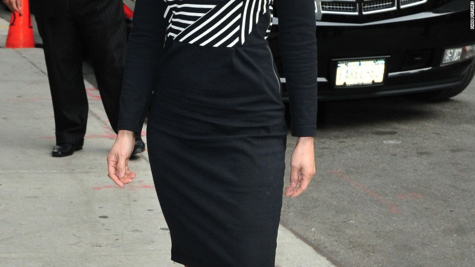 "Lucy Liu smiles as she arrives at ""Late Show with David Letterman"" on October 9."