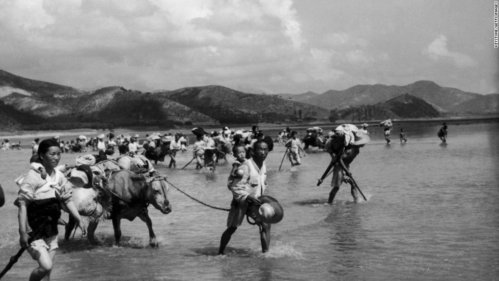 North Korean refugees cross the Naktong River in South Korea on August 6, 1950, just a short time before the beginning of the conflict between North and South Korea. The U.N. forces in Korea had set a time limit of 15 hours for crossing the river. In 1954, the Nobel Peace Prize was awarded to the UNHCR, the Office of the United Nations High Commissioner for Refugees.