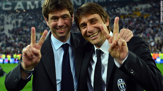 Juventus president Andreas Agnelli celebrates their 2013 Serie A win with the club's manager Antonio Conte