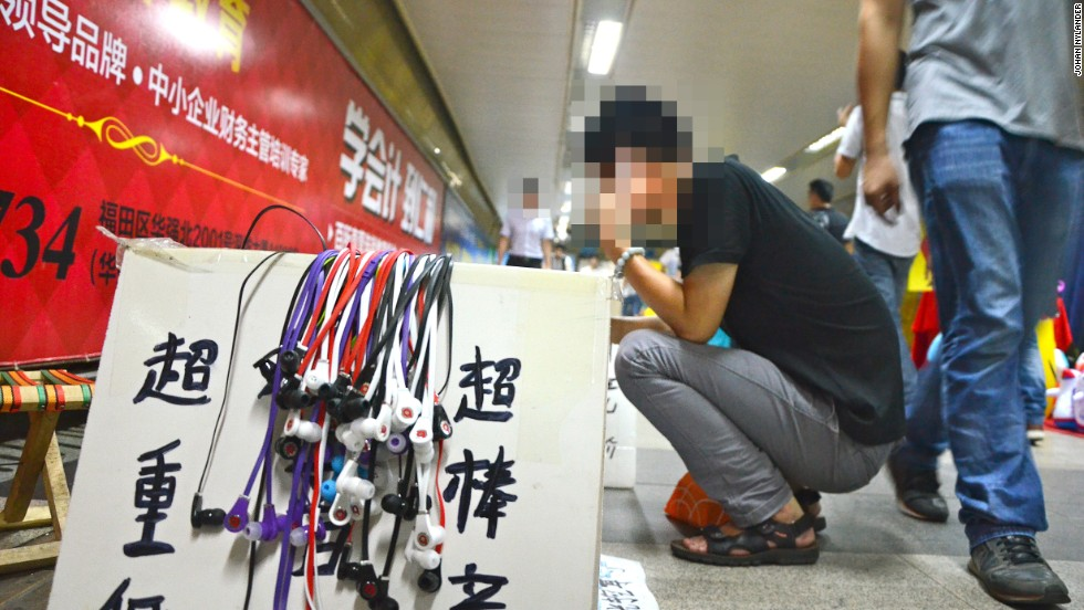 On the streets and down in the Shenzhen subway, in-ear fake Beats headphones are sold for as little as $1.