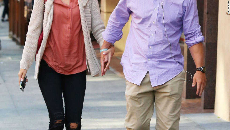 Mark Wahlberg and his wife try to get some shopping done in Beverly Hills on October 10.